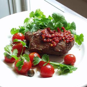 Strudsesteaks med stegt tomater